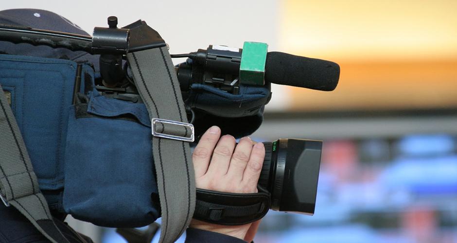 Cameraman And Newscast
